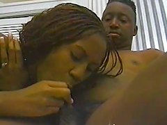Booty ebony sits on her black man  to ride him