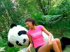 Weird sex in the woods with a huge toy panda with strap on
