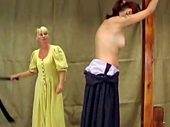 Mature blonde domina flogging a young girl