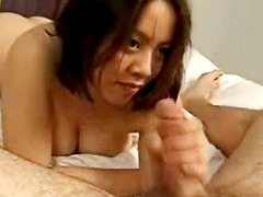 Asian gives fat guy a footjob