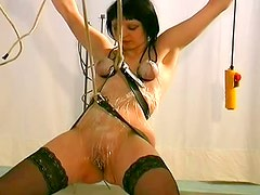 Short haired babe with tied hands is tit tortured