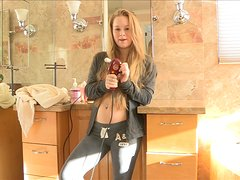 Madison moans loudly while toying her pussy in a bathroom