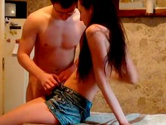 Well shaped brunette teen gets her mouth fucked tough on kitchen table