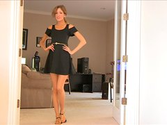 Emily enjoys posing for the cam in her high heels and short dress