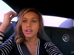 Lustful girl Kennedy shows her natural tits in a car