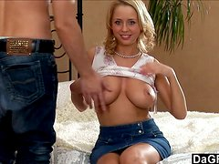 A big breasted Abigail White gives a blowjob to her boyfriend