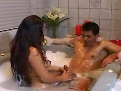 Asian milf presents handjob in the shower and jacuzzi