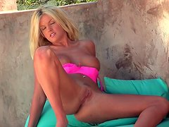 Solo blonde Tommie Jo is getting naked on the cam
