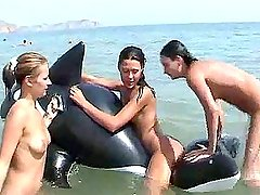 Lots of ladies naked at the beach and in water