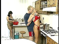 Two hot chicks share hot hunk's cock