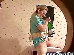 Gloryhole bukkake slut fucks a champagne bottle