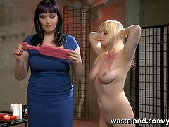 Blonde sub is spanked hard by lesbian dominatrix