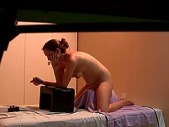 Voyeur spying on girl riding her Sybian while watching porn