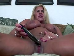 Muscular tanned girl has dildo sex