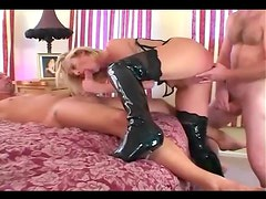 Double penetration in a corset stockings and boots