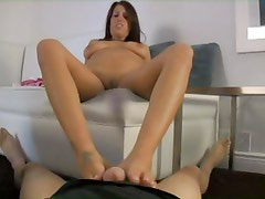 One dark haired babe would rather use her feet than mouth to please dick