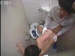 Asian Nurse and Cleaning Lady Help a Patient