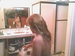 Mature milf Gwen spied in her bathroom