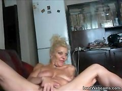 Blonde granny plays with her pussy on webcam