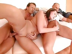 Dick hungry brunette gets a double dose of cock