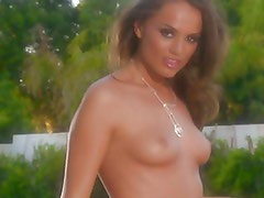 Tori Black teases the camera by the pool