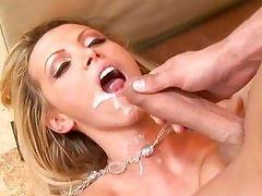 Nikki Benz gets her face drizzled with warm cum
