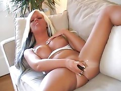Gorgeous blonde rams her dildo deep in her hot slot