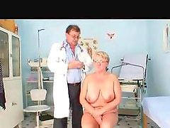 Doctor examines the chubby older babe