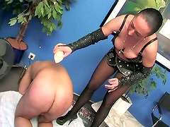 Busty brunette mistress pours hot wax on slaves ass