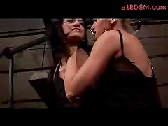 Girl With Tied Arms Whipped By Mistress In The Workshop