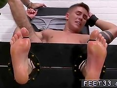 Male stud cowboy having boots off and feet