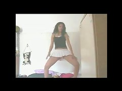 Short skirt teen dances sensually