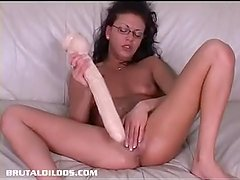 Brunette French Canadian amateur filled by a long brutal dildo
