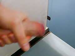 Wanking in the toilet cubicle at work with cumshot