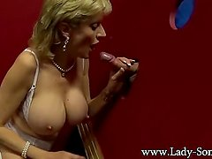 Blonde milf Lady Sonia sucking big dick on the glory hole
