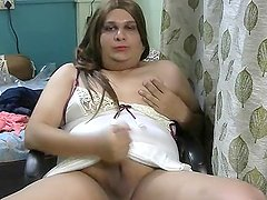 blonde indian shemale milf stroking in satin gown