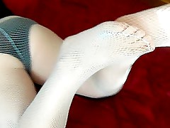 wife in blue fishnets on the bed