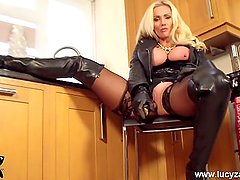 Busty blonde Milf Lucy Zara in all leather masturbates toying her wet pussy