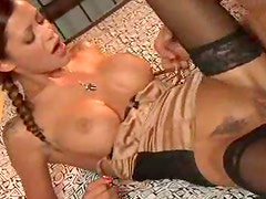 Busty pigtailed minx gets her shaved pussy ploughed