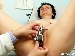 Examining a hairy mature pussy