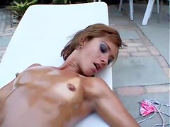 Bronzed bikini clad hottie oils down then masturbates