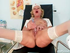 Blonde granny opens her legs and fills her pussy