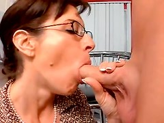 Glass wearing housewife sucks younger mans cock