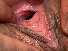 Hinano's pink pussy hole is spread open for a hot close up shot