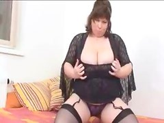 Fat chick with fantastic tits in lingerie