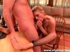 Ripped fishnets on milf giving footjob