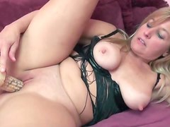 Daring blonde mature using corn on her tight pussy