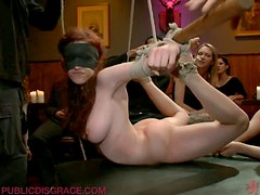 Busty Redhead Gets The BDSM Special Treatment In Public