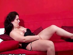 Mature brunette housewife touching