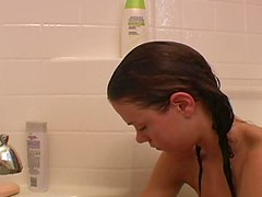 Teen takes a bath and rubs lotion on legs